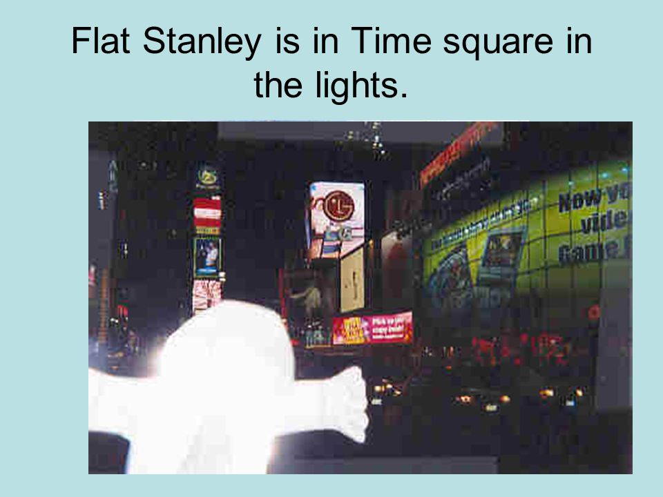 Flat Stanley is in Time square in the lights.