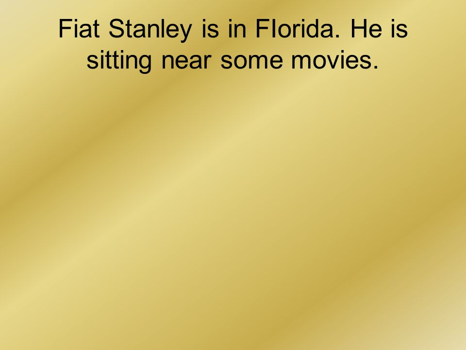 Fiat Stanley is in FIorida. He is sitting near some movies.