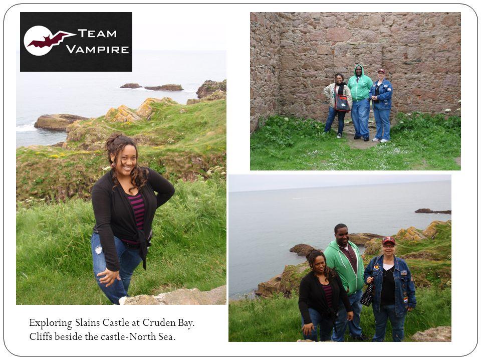 Exploring Slains Castle at Cruden Bay. Cliffs beside the castle-North Sea.