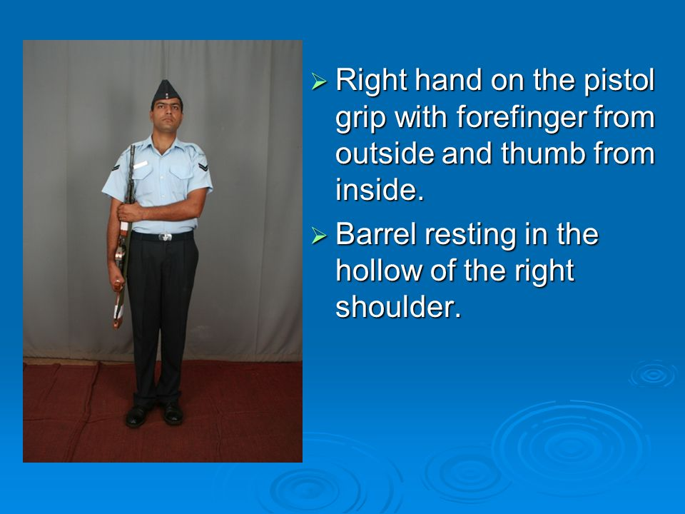  Right hand on the pistol grip with forefinger from outside and thumb from inside.