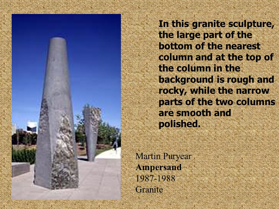 In this granite sculpture, the large part of the bottom of the nearest column and at the top of the column in the background is rough and rocky, while