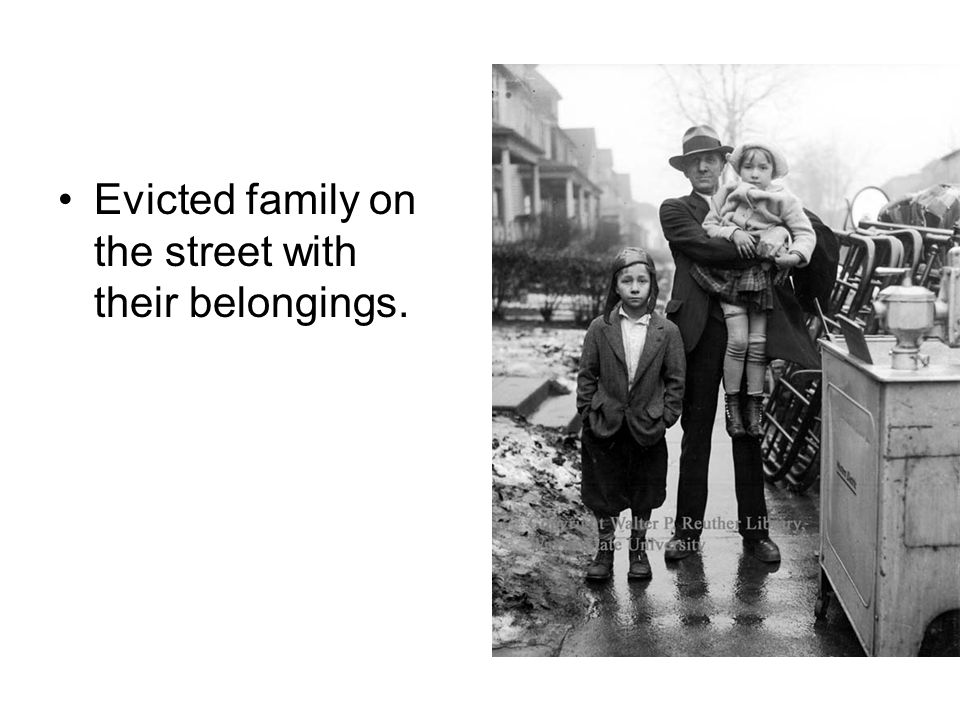 Evicted family on the street with their belongings.