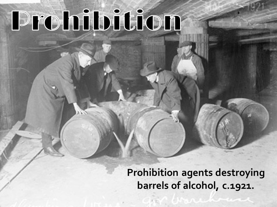 Prohibition agents destroying barrels of alcohol, c.1921.