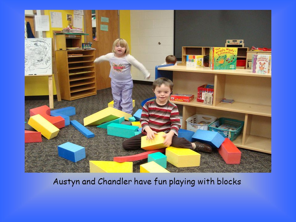 Austyn and Chandler have fun playing with blocks