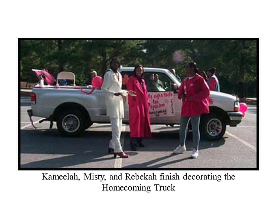 Kameelah, Misty, and Rebekah finish decorating the Homecoming Truck