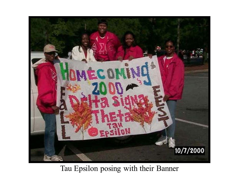 Tau Epsilon posing with their Banner