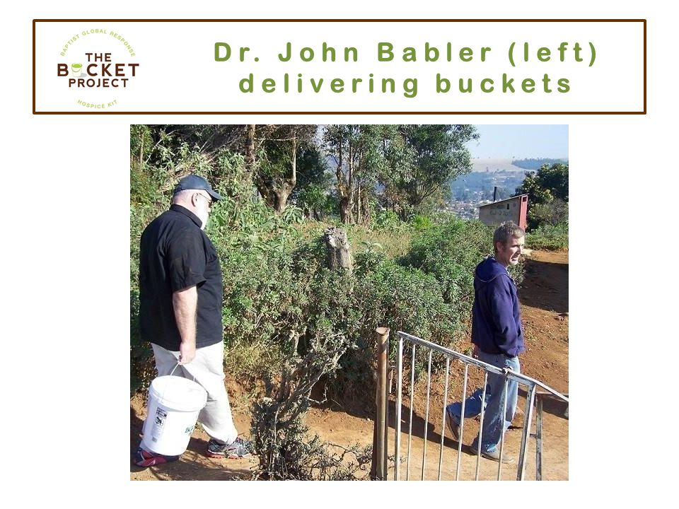 Dr. John Babler (left) delivering buckets