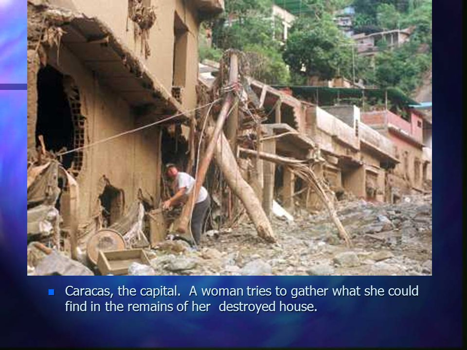 n Caracas, the capital. A woman tries to gather what she could find in the remains of her destroyed house.