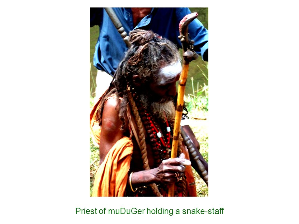 Priest of muDuGer holding a snake-staff