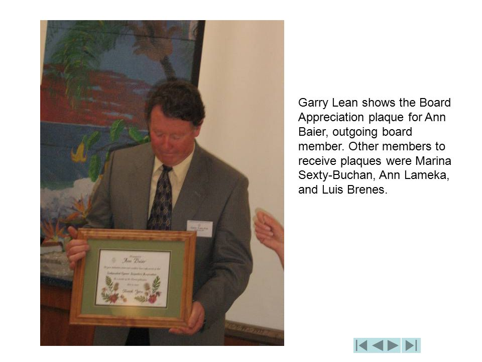 Garry Lean shows the Board Appreciation plaque for Ann Baier, outgoing board member.