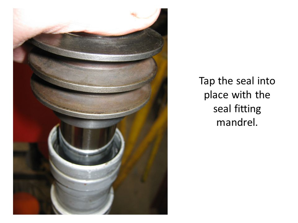 Tap the seal into place with the seal fitting mandrel.