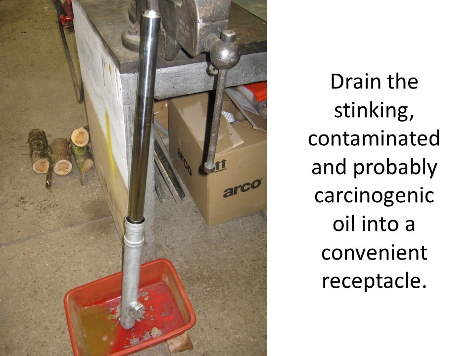 Drain the stinking, contaminated and probably carcinogenic oil into a convenient receptacle.
