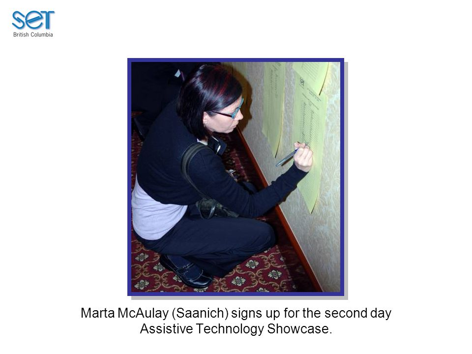 Marta McAulay (Saanich) signs up for the second day Assistive Technology Showcase.