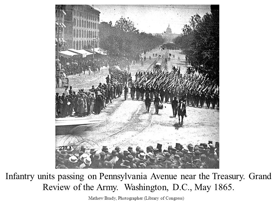 Infantry units passing on Pennsylvania Avenue near the Treasury.
