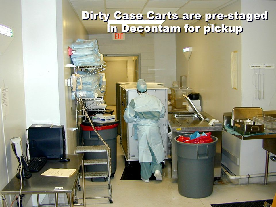 Dirty Case Carts are pre-staged in Decontam for pickup