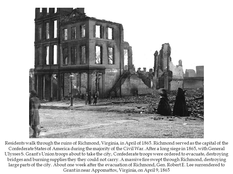 Residents walk through the ruins of Richmond, Virginia, in April of 1865.