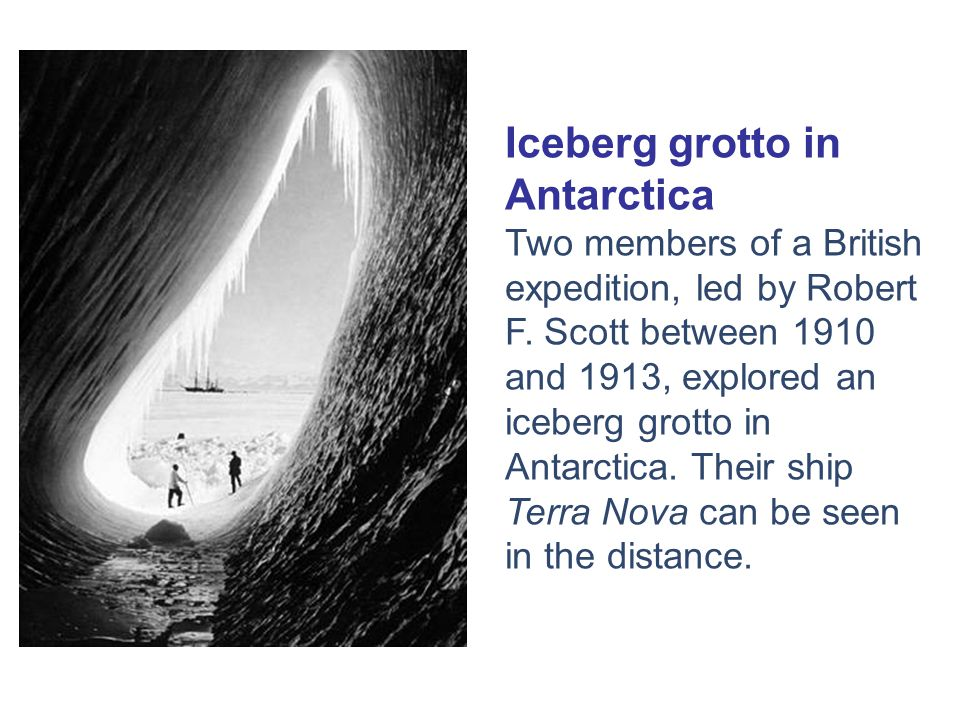 Iceberg grotto in Antarctica Two members of a British expedition, led by Robert F.