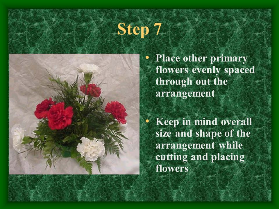 Step 7 Place other primary flowers evenly spaced through out the arrangement Keep in mind overall size and shape of the arrangement while cutting and