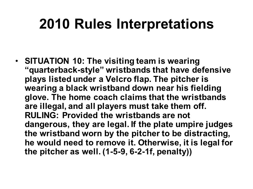 2010 Rules Interpretations SITUATION 10: The visiting team is wearing quarterback-style wristbands that have defensive plays listed under a Velcro flap.