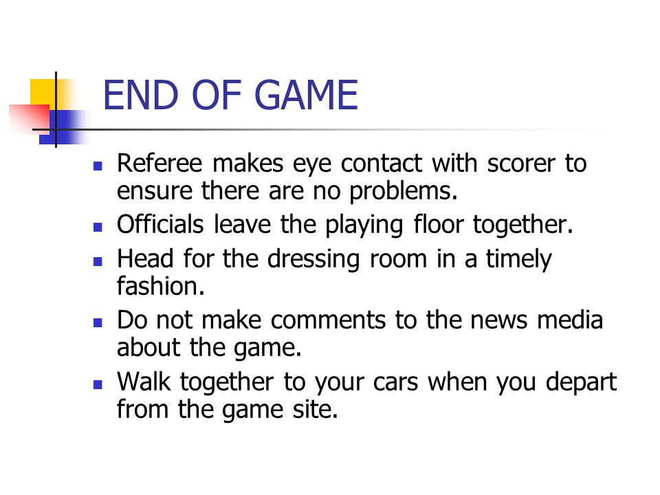 END OF GAME Referee makes eye contact with scorer to ensure there are no problems.