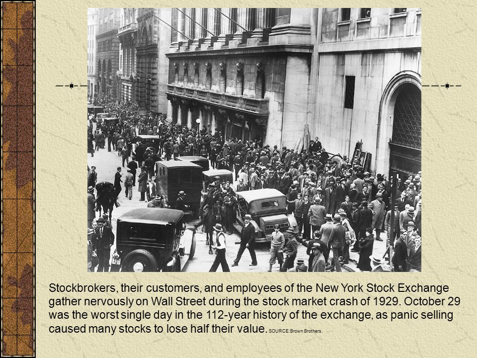 Stockbrokers, their customers, and employees of the New York Stock Exchange gather nervously on Wall Street during the stock market crash of 1929.