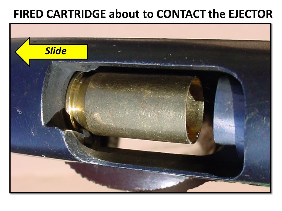 FIRED CARTRIDGE about to CONTACT the EJECTOR Slide