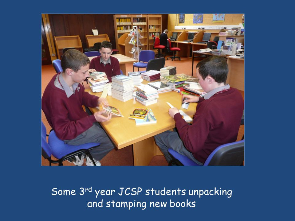 Some 3 rd year JCSP students unpacking and stamping new books