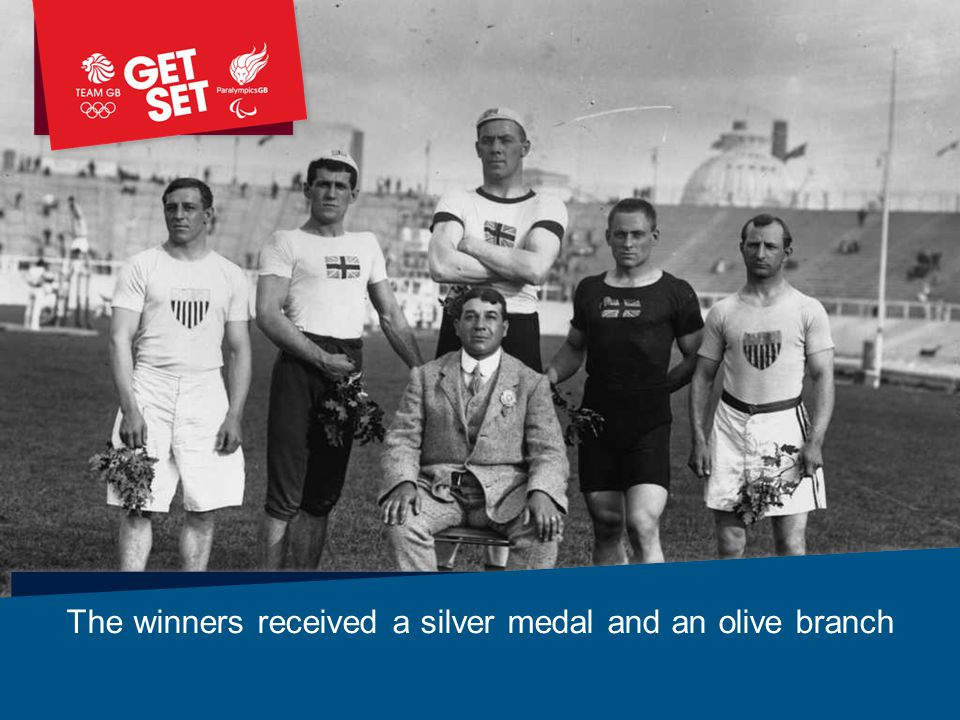 The winners received a silver medal and an olive branch