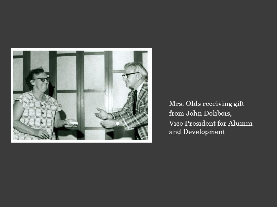 Mrs. Olds receiving gift from John Dolibois, Vice President for Alumni and Development
