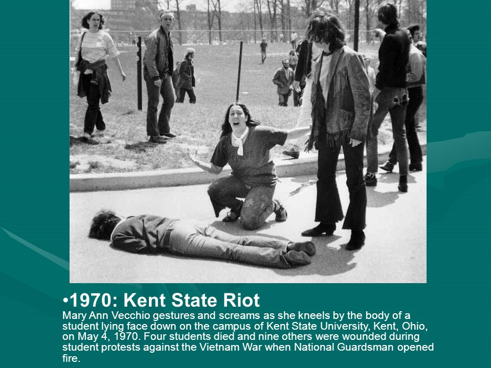 1970: Kent State Riot Mary Ann Vecchio gestures and screams as she kneels by the body of a student lying face down on the campus of Kent State University, Kent, Ohio, on May 4, 1970.