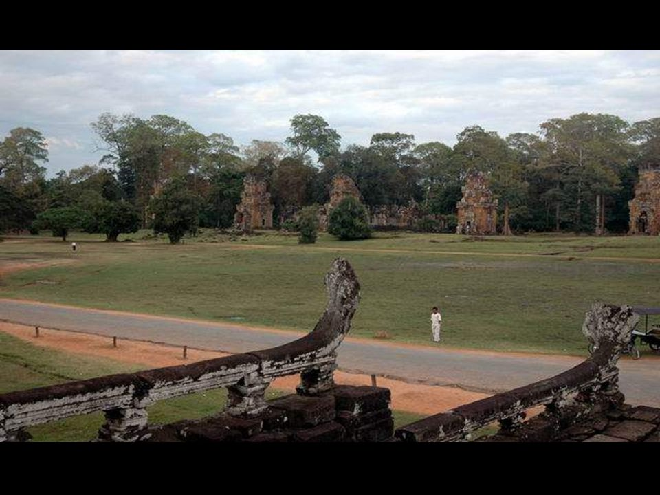The gates of Angkor Thom - the ancient capital - are guarded by ferociouos stone soldiers. Many of the buildings, including the 8 meter high city wall
