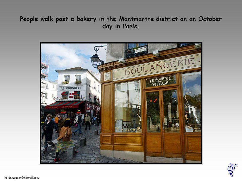 holdemqueen@hotmail.com People walk past a bakery in the Montmartre district on an October day in Paris.