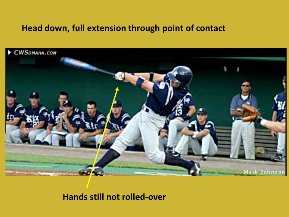 Head down, full extension through point of contact Hands still not rolled-over