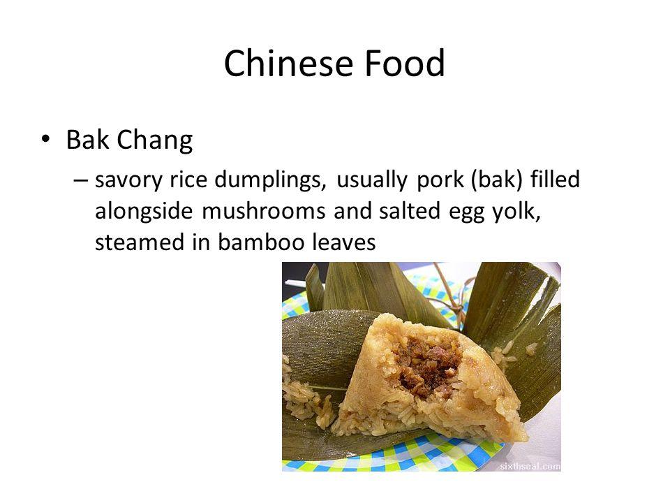 Chinese Food Bak Chang – savory rice dumplings, usually pork (bak) filled alongside mushrooms and salted egg yolk, steamed in bamboo leaves