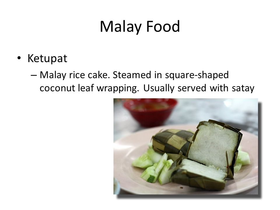 Malay Food Ketupat – Malay rice cake. Steamed in square-shaped coconut leaf wrapping.