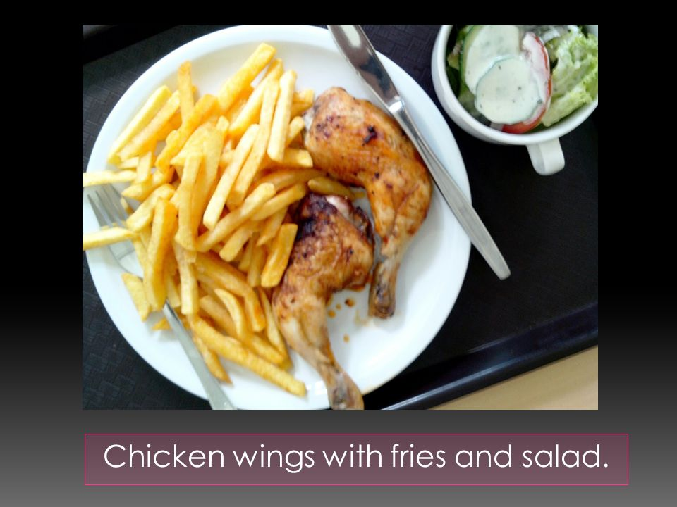 Chicken wings with fries and salad.