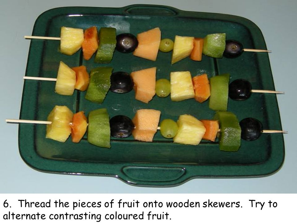 6. Thread the pieces of fruit onto wooden skewers. Try to alternate contrasting coloured fruit.