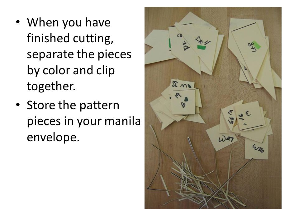 When you have finished cutting, separate the pieces by color and clip together. Store the pattern pieces in your manila envelope.