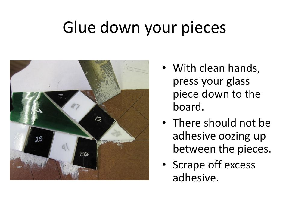Glue down your pieces With clean hands, press your glass piece down to the board.