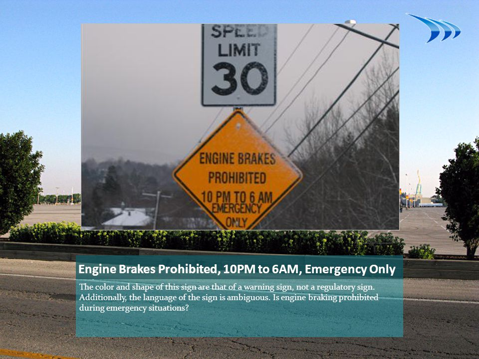 Engine Brakes Prohibited, 10PM to 6AM, Emergency Only The color and shape of this sign are that of a warning sign, not a regulatory sign.