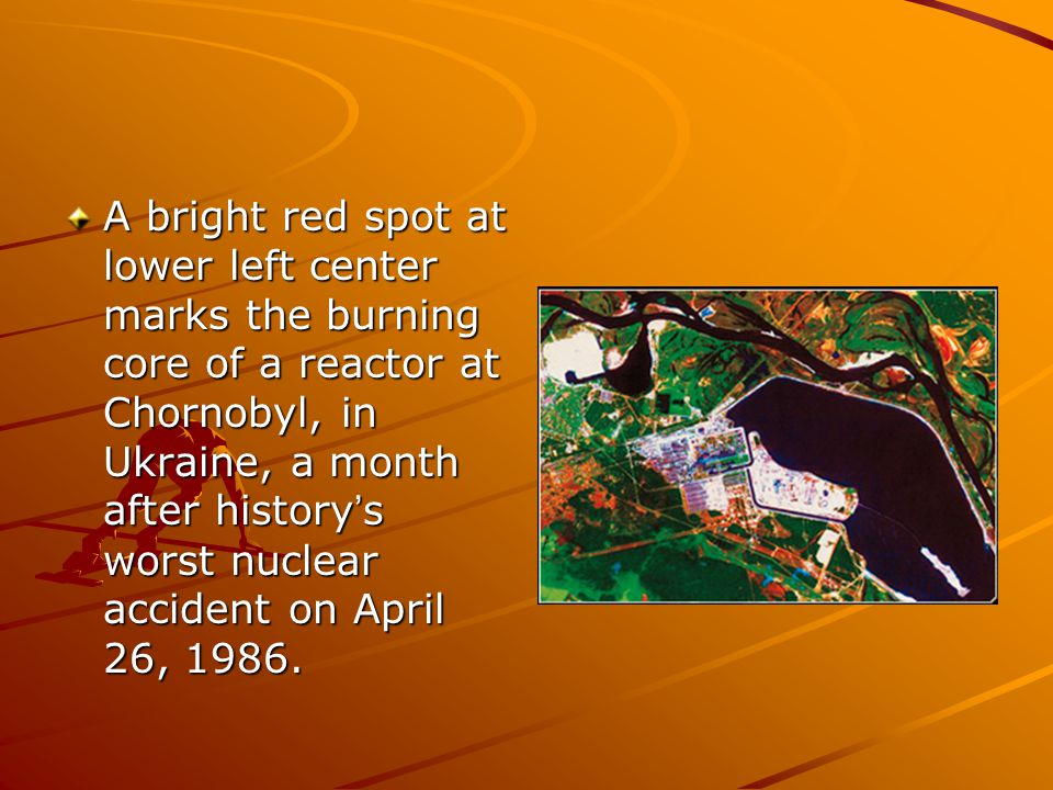 A bright red spot at lower left center marks the burning core of a reactor at Chornobyl, in Ukraine, a month after history ' s worst nuclear accident on April 26, 1986.