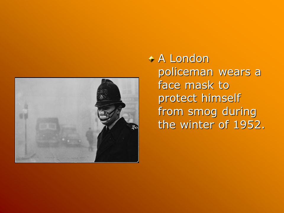 A London policeman wears a face mask to protect himself from smog during the winter of 1952.