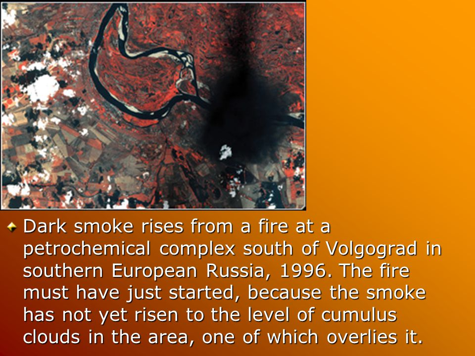 Dark smoke rises from a fire at a petrochemical complex south of Volgograd in southern European Russia, 1996.