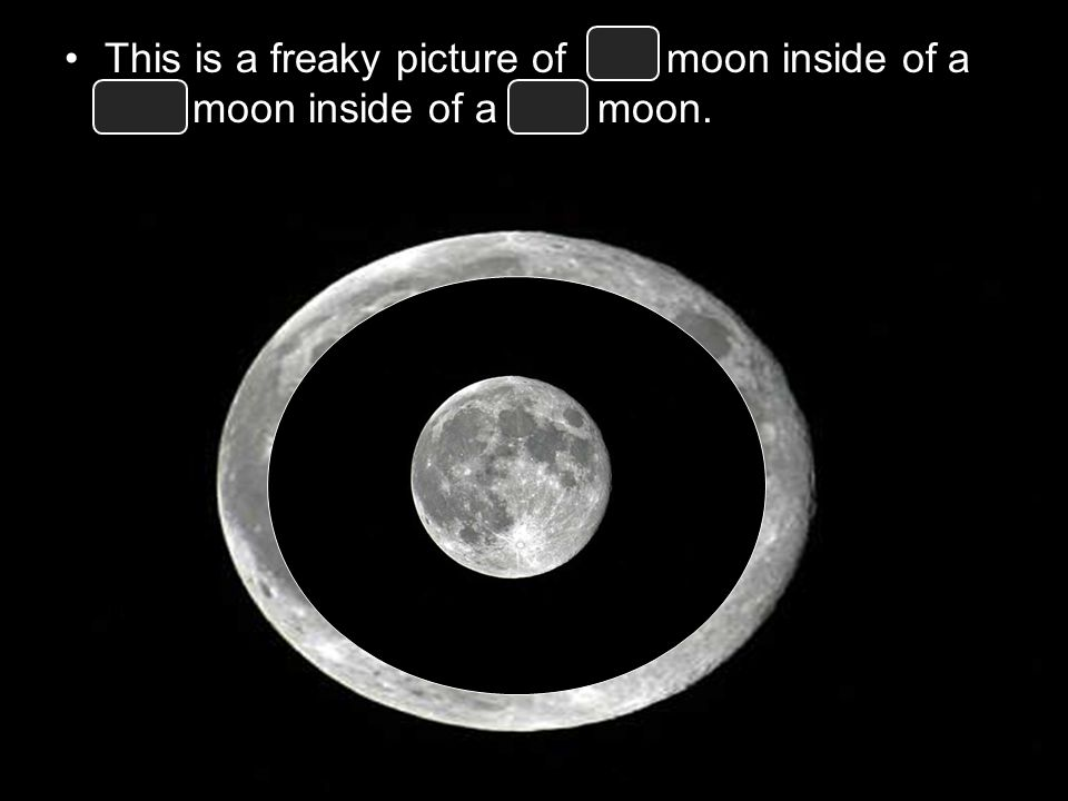 This is a freaky picture of full moon inside of a new moon inside of a full moon.
