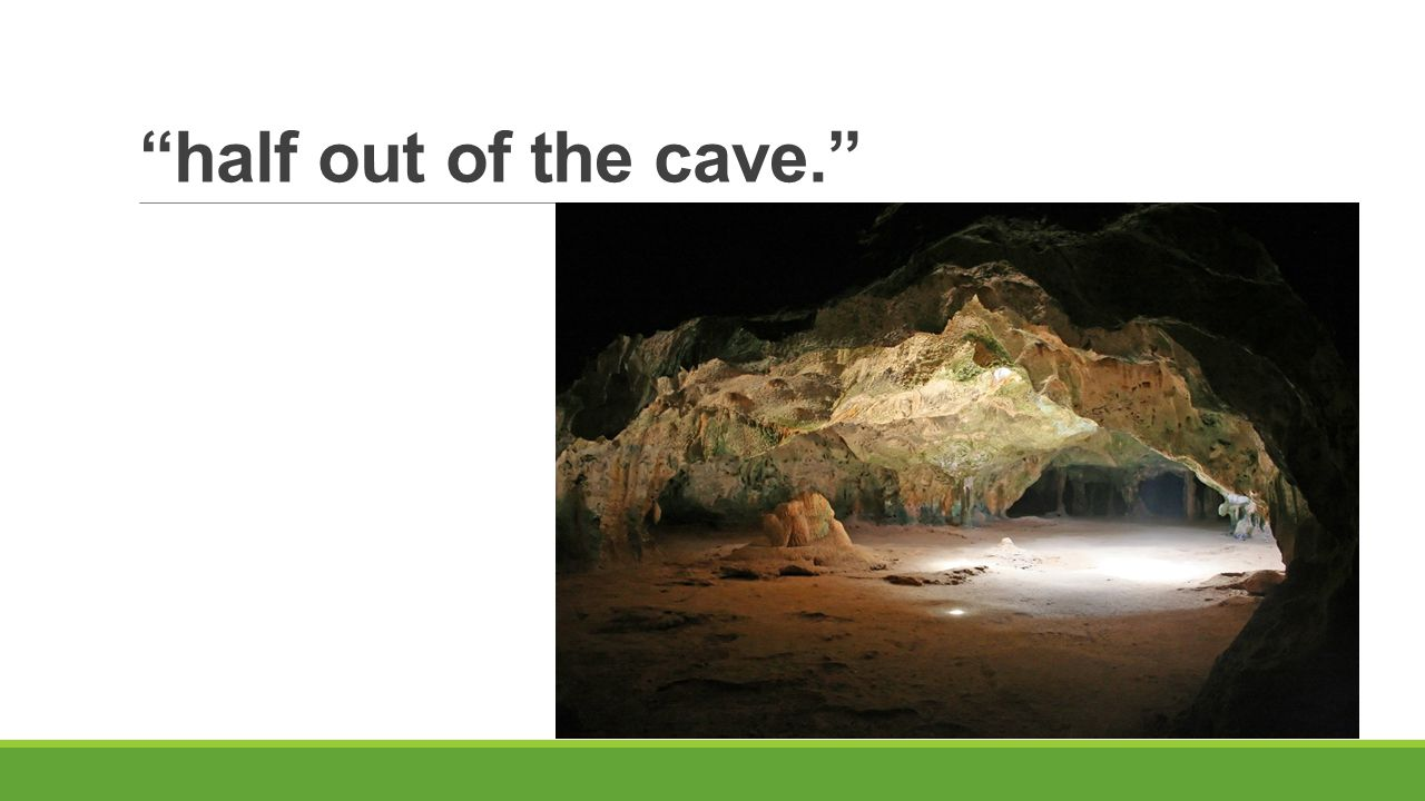 half out of the cave.