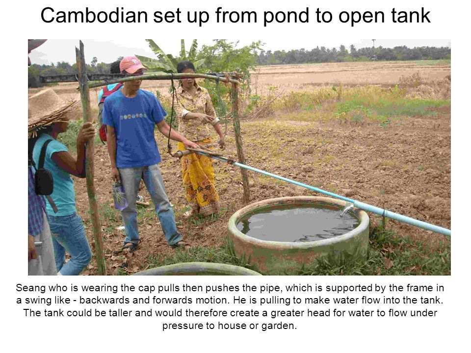 Cambodian set up from pond to open tank Seang who is wearing the cap pulls then pushes the pipe, which is supported by the frame in a swing like - bac