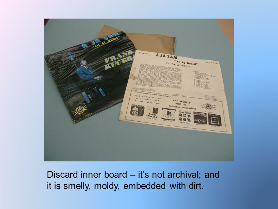 Discard inner board – it's not archival; and it is smelly, moldy, embedded with dirt.