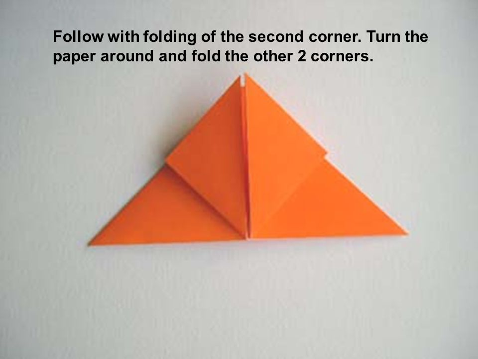 Follow with folding of the second corner. Turn the paper around and fold the other 2 corners.