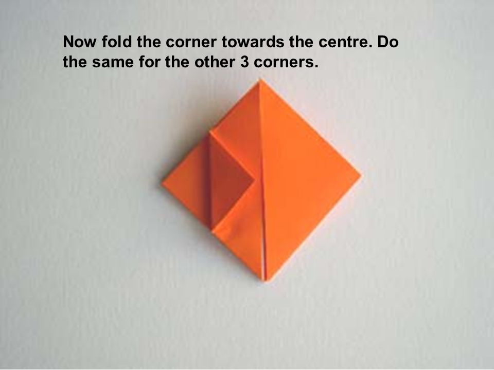 Now fold the corner towards the centre. Do the same for the other 3 corners.