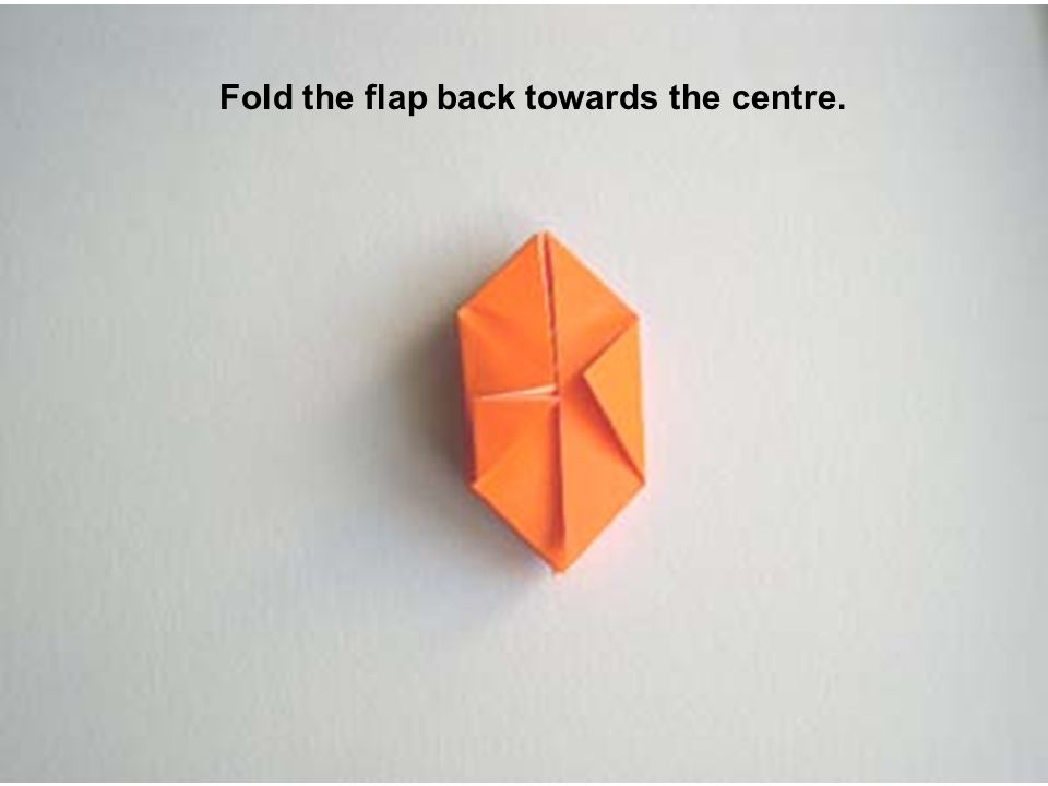 Fold the flap back towards the centre.